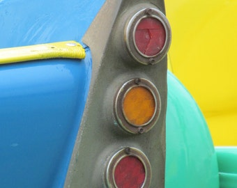 TAKIN' A RIDE, a carnival ride, that is. Detail from one of the midway rides at a county fair in south Louisiana. Yep, another backroad.