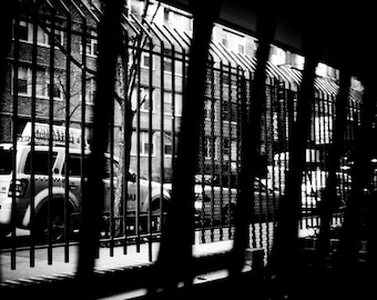NYC, high contrast, black and white photograph of a taxi through an apartment window in Chelsea