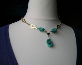 A repurposed upcycled turquoise art glass bead and gold tone metal assemblage necklace