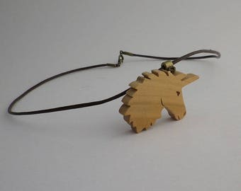 Unicorn in cherry wood and brown leather pendant