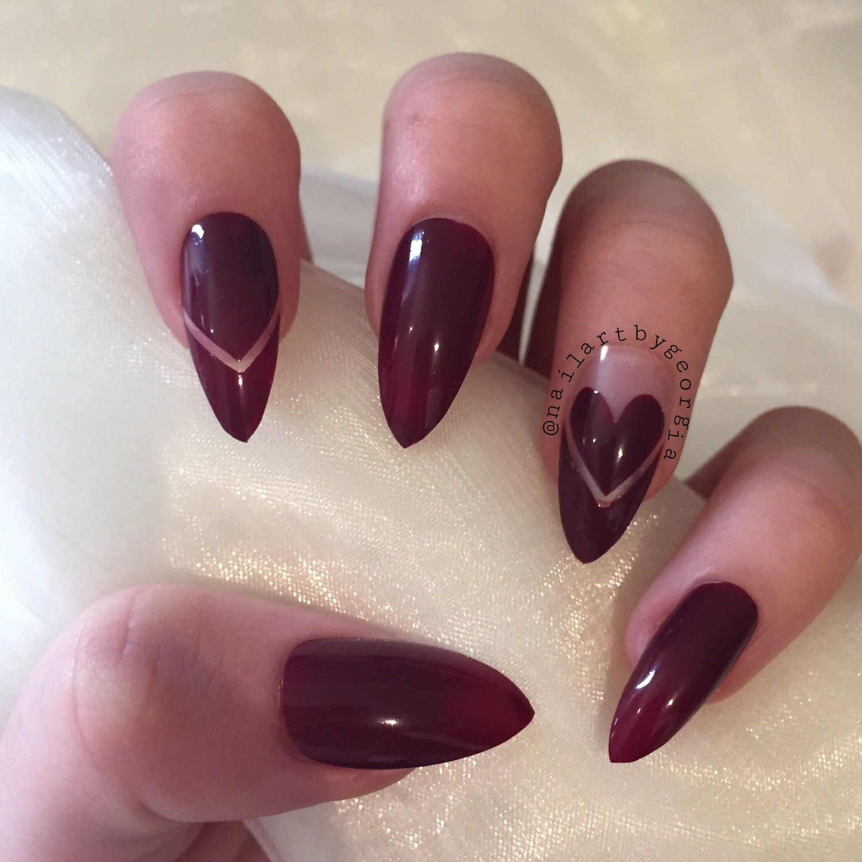 Burgundy stiletto nails with negative chevron design and love heart ...