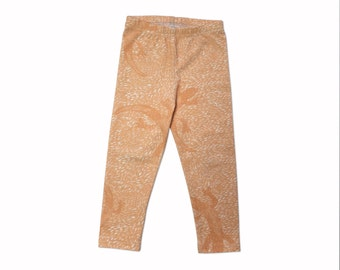 Orange lizard leggings