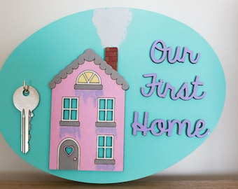 Our first home sign.  Colourful.  Hook.  Cottage.