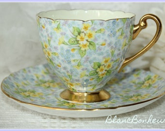 Shelley, England: ''Primrose'' blue and yellow chintz tea cup & saucer