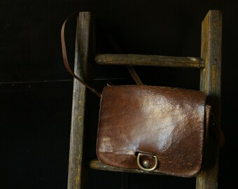 Vintage rusty brown leather hand bag.