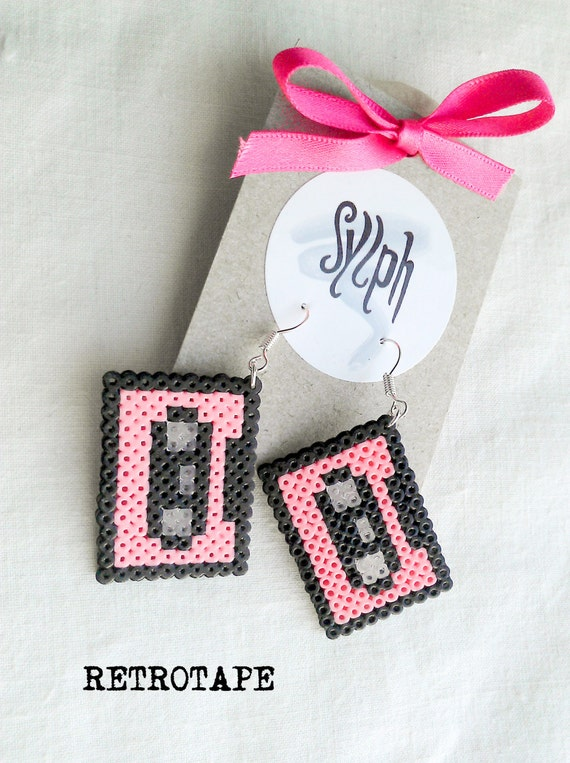 Pixelated pink geeky Retrotape cassette earrings made of Hama Mini Beads made with love for pixel-perfect 8bit music lovers