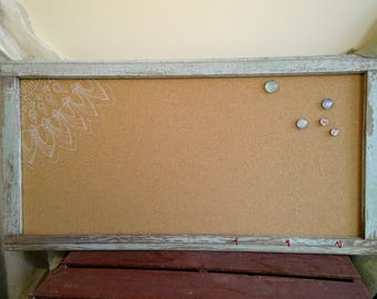 Repurposed vintage antique window frame with corkboard and small hooks for keys