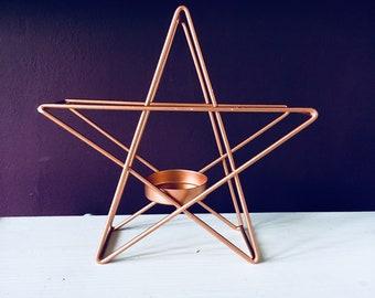 Copper / rose gold wire star shaped tea light holder