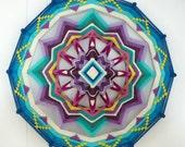 Love of Beauty, a 16 inch, 12-sided Ojo de Dios, by custom order