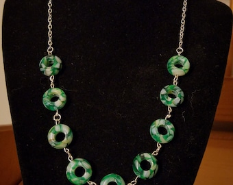 Green and white donut necklace