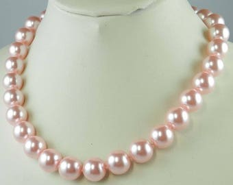 4 10MM ROUND PINK SHELL BEADS.