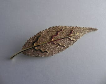 BSK gold tone leaf brooch