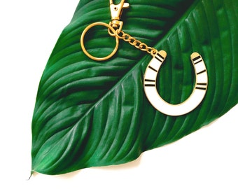 lucky serape horseshoe keychain in black and white on gold