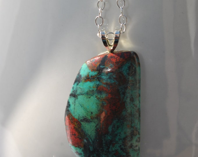 Stunning Sonoran Sunrise stone with turquoise and red colors suspended on a sterling silver linked necklace simple, boho, minimalist