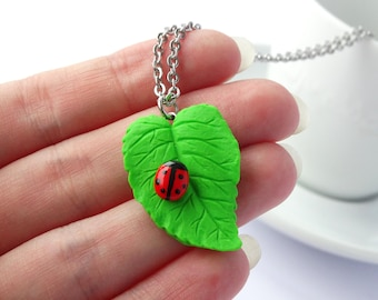 Cute red ladybug on a leaf charm necklace bug animal insect cute kawaii colourful jewelry handmade polymer clay
