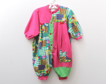 Vintage cotton playsuit with bright rabbit/vegetable patch patchwork-style design, size 68 (approx 6 months)