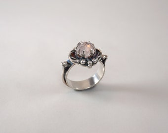 Rose Quartz.  Sterling silver ring with rose cut rose quartz cabochon.  Size 6.5.  Handmade. One of a kind.  Soft pink.