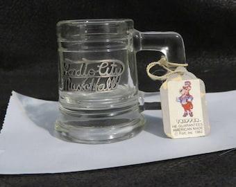 "1982 Radio City Music Hall Souvenir Shot Glass/ Tiny Mug- Still Has Tag- Never Used- Measures 2 1/2"" Tall 2"" Wide- Holds 1 oz Liquid"