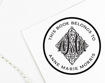 Book label stamp, library of stamp, this book belongs to with monogram