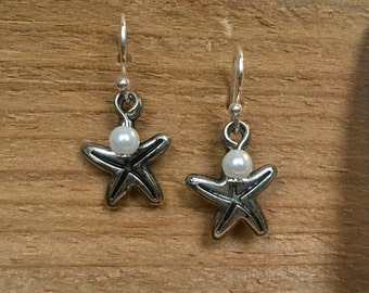 Silver starfish with pearl drop earrings.