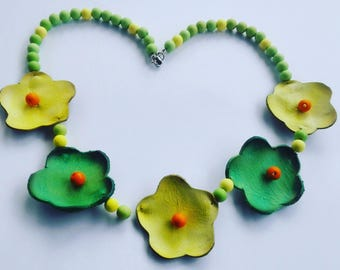 Color necklace with beads and leather flowers. Green and yellow choker