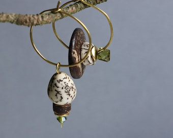 hammered brass hoop earrings with exotic nut dangle - asymmetrical - mismatched - ethnic boho botanical jewelry