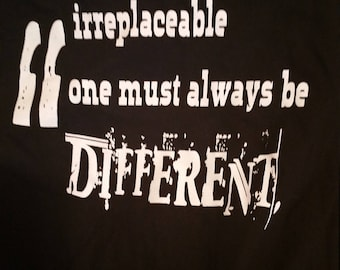 "The Black Sheep Asylum Shirt with ""In order to be irreplaceable one must always be different"" on the back"
