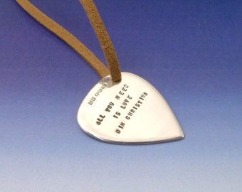 Sterling Silver Guitar Pick (plectrum) with leather thong necklace. Personalised with a stamped message, name, phrase, words, quote, poem.