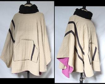 Fleece lined poncho beige purple and black