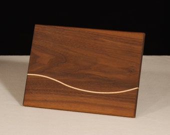 Small Cheese Board. Could be a serving piece or a small cutting board for a bar. It makes a nice inexpensive gift.