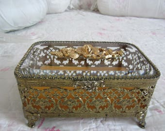 Lovely gold tone jewelry box with a beveled glass lid and gold velvet inside