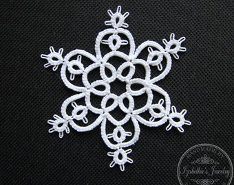 Small hand tatted Christmas Snowflake III