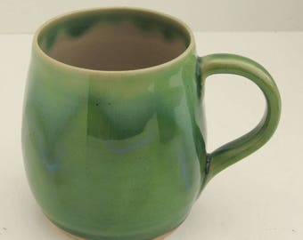 Stoneware jade green mug with icy frosting
