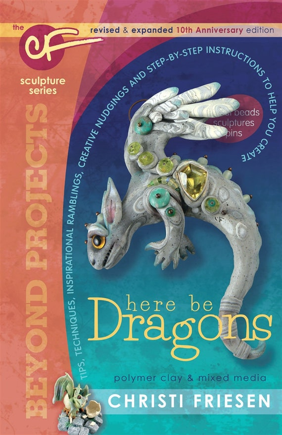 Drangons with Christi Friesen's book, Sculpting Draons and other Mythical Creatures out of Polymer Clay and other mixed media.