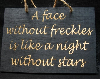 A face without freckles is like a night without stars wooden sign
