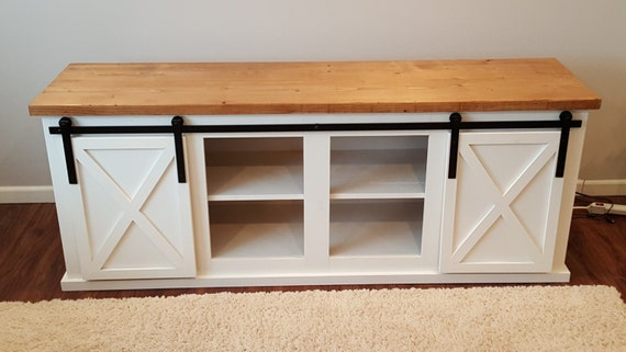 items similar to sliding barn door tv stand on etsy. Black Bedroom Furniture Sets. Home Design Ideas