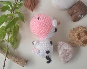 Amigurumi cow doll, little cattle plush toy. Handmade farm animal.