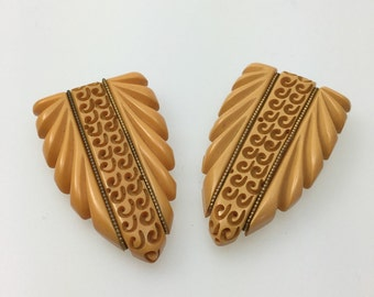 Pair of Deep Carved Butterscotch Bakelite Vintage Deco Dress Clips
