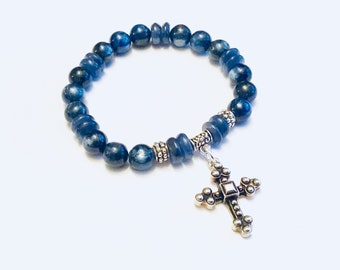 AA Kyanite round and heishi and and silver spacer bead bracelet with silver cross charm