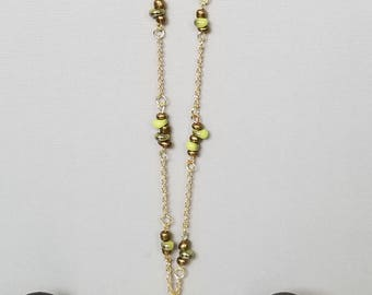 Gold plated necklace with jeweled pendant and beads.