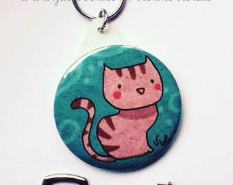 Round Keychain shows. Striped cat