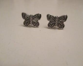 Petite silver butterfly post earrings with clutch backs.