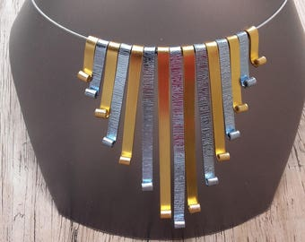 Evening necklace gold and icy blue striated