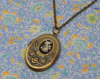 Oval Locket with Black and White Floral Cameo Necklace
