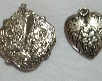 Two metal pendants for necklaces