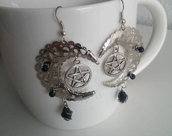 Large moon witch earrings.