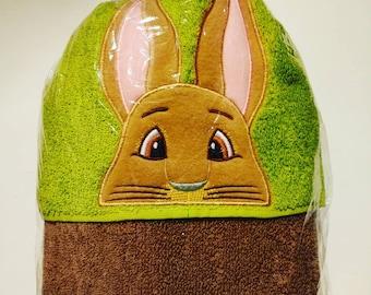 Hooded towel with bunny rabbit peeker.