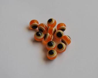 12 beads evil eye 8mm light orange