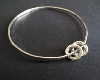 Sterling silver bangle with two textured rings