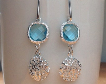 Round silver filigree and blue crystal earrings